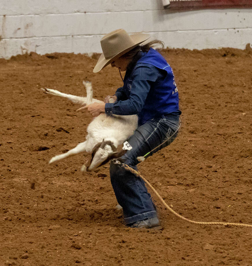 Odessa College's Bliss Bolton ties a goat during the goat-tying event at the 35th annual Wrangler Rodeo on Thursday at Ector County Coliseum. Photo: Jacy Lewis/191 News