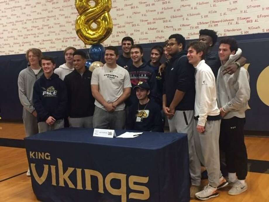 Matt Garavel, seated, celebrates with his King School football teammates Friday after signing his letter of intent to play football at Pace University in the fall. Photo: Contributed Photo