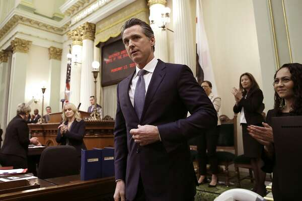 FILE - In this Feb. 12, 2019, file photo, California Gov. Gavin Newsom receives applause after delivering his first state of the state address to a joint session of the legislature at the Capitol in Sacramento, Calif. Newsom is sparring with President Donald Trump over $3.5 billion in federal money the state was awarded to build a high-speed rail line between Los Angeles and San Francisco. (AP Photo/Rich Pedroncelli, File)