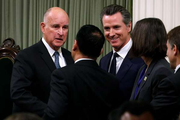 Gov. Jerry Brown and Lt. Gov Gavin Newsom greets assemblymembers and state senators after the four-term governor delivered his final State of the State address in Sacramento, Calif. on Thursday, Jan. 25, 2018.