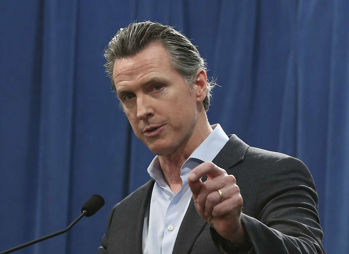 California Gov. Gavin Newsom discusses his decision to withdraw most of the National Guard troops from the nation's southern border and changing their mission, during a Capitol news conference Monday, Feb. 11, 2019, in Sacramento, Calif. (AP Photo/Rich Pedroncelli)