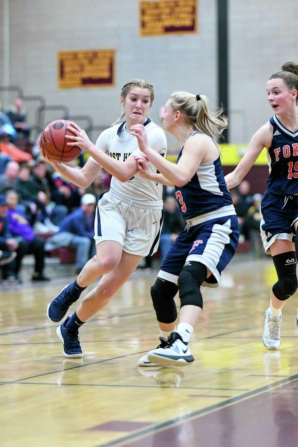 East Haven senior guard Makenzie Helms drives against Foran in an SCC girls basketball tournament quarterfinal game on Saturday. Photo: David G. Whitham / For Hearst Connecticut Media / DGWPhotography