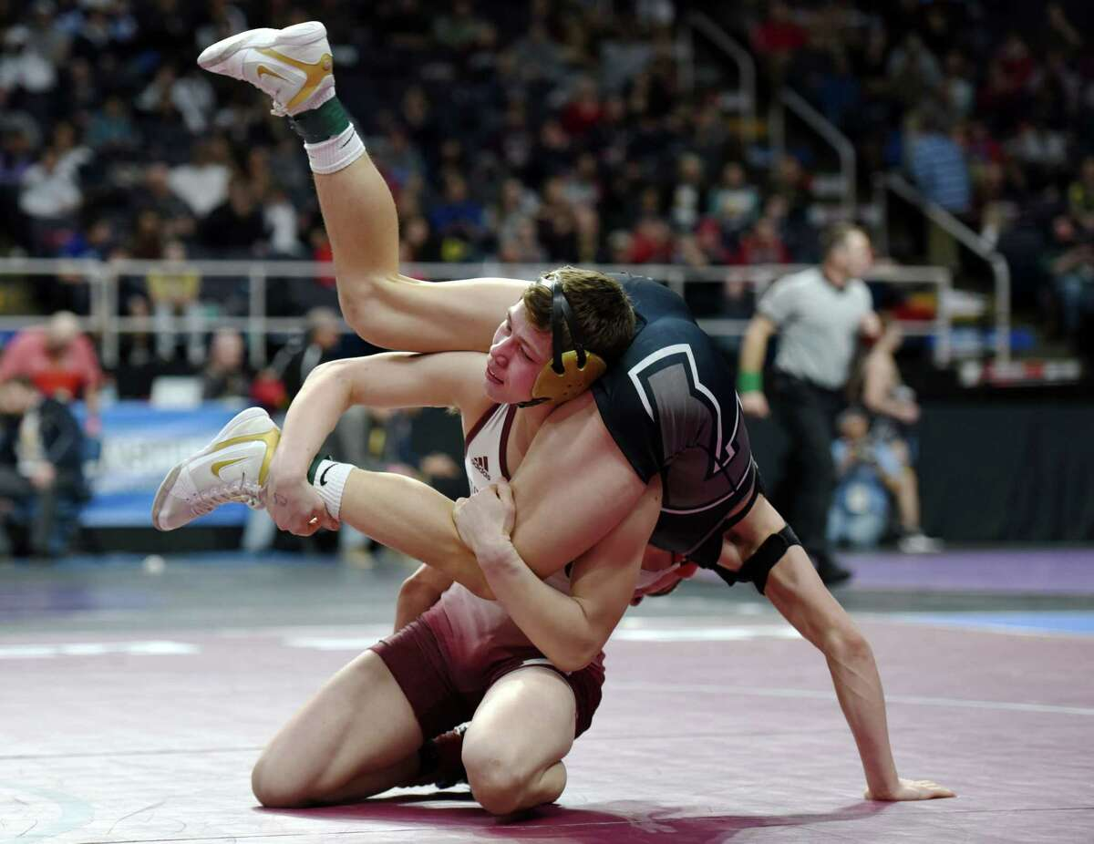 Duanesburg's Zack Lawrence wrestles Saranac's Bryce Smith in the division II 152 pound weight class during the NYSPHSAA Division I and II wrestling finals on Friday, Feb. 22, 2019 at the Times Union Center in Albany, NY. (Phoebe Sheehan/Times Union)