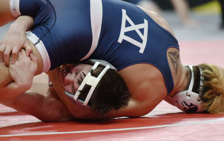 Shenendehowa's Brock Delsignore, bottom, wrestles Rocky Point's Kris Ketchum in the division I 145 pound bout during the NYSPHSAA Division I and II wrestling finals on Friday, Feb. 22, 2019 at the Times Union Center in Albany, NY. (Phoebe Sheehan/Times Union)