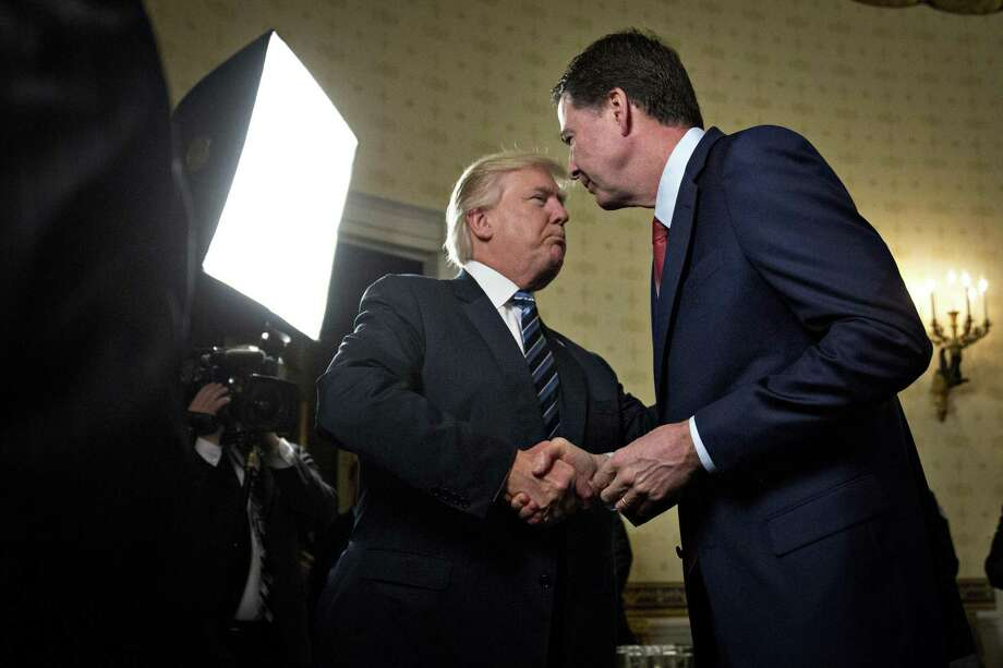 President Donald Trump greets FBI director James Comey during a 2017 reception in the White House. Trump's firing of Comey was well within the president's constitutional authority and does not represent obstruction of justice. Photo: Andrew Harrer /Getty Images / 2017 Getty Images 2017 Getty Images