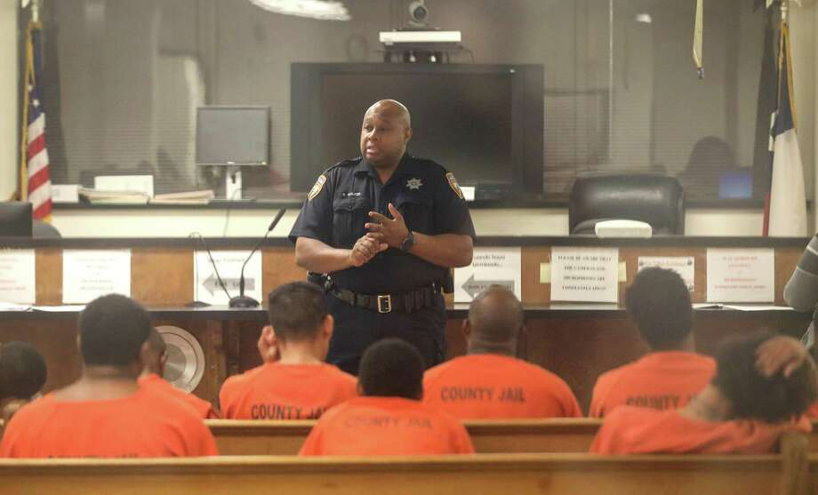 Harris County Sheriff's Deputy D. Walker speaks to defendants before a probable cause hearing in Houston. Bail reform is breaking ground in Harris County. Photo: Jon Shapley / Staff File Photo / © 2017 Houston Chronicle