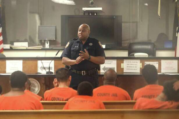 Harris County Sheriff's Deputy D. Walker speaks to defendants before a probable cause hearing in Houston. Bail reform is breaking ground in Harris County.