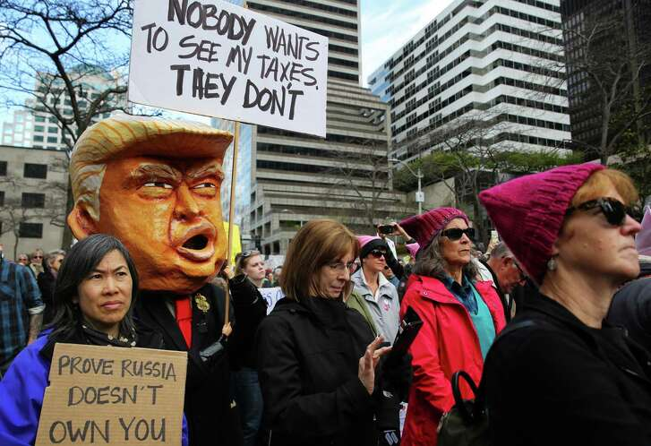 Protesters moves through downtown Seattle in 2017, as part of a nationwide call for President Donald Trump to release his tax returns. A reader suggests Trump take Robert Mueller's side instead of opposing him.