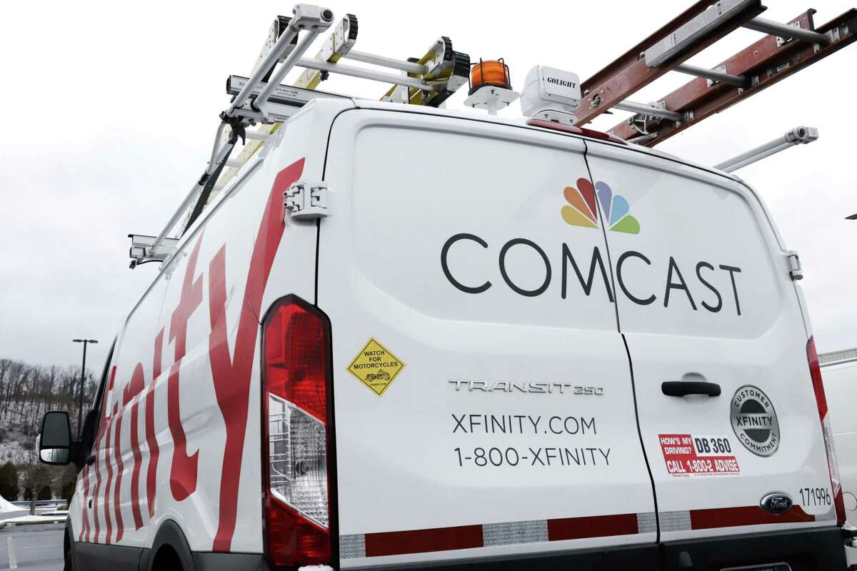This is a Comcast truck in Pittsburgh Thursday, Jan. 24, 2019. Comcast has raised the speeds for its low-cost Internet Essentials service.
