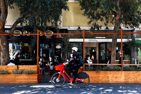 People lunch at a public parklet in front of Patxi�s Chicago Pizza and Souvla, located in the 500 block of Hayes St., in San Francisco, Calif., on Friday, February 22, 2019.