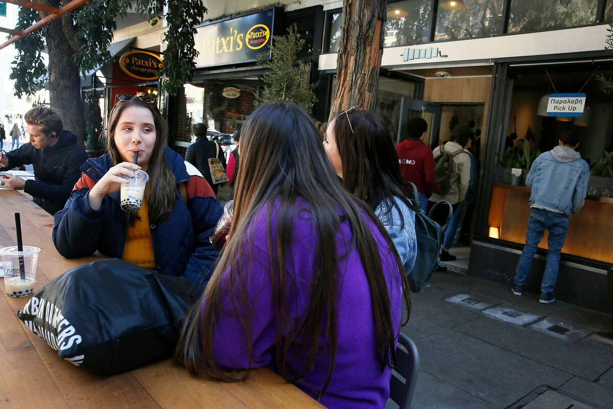 From left: Bella Hobaugh, Erin Bernier and Sara Hand at the parklet outside Souvla restaurant and Patxi's pizzeria on Hayes Street, Monday, Feb. 18, 2019, in San Francisco, Calif.