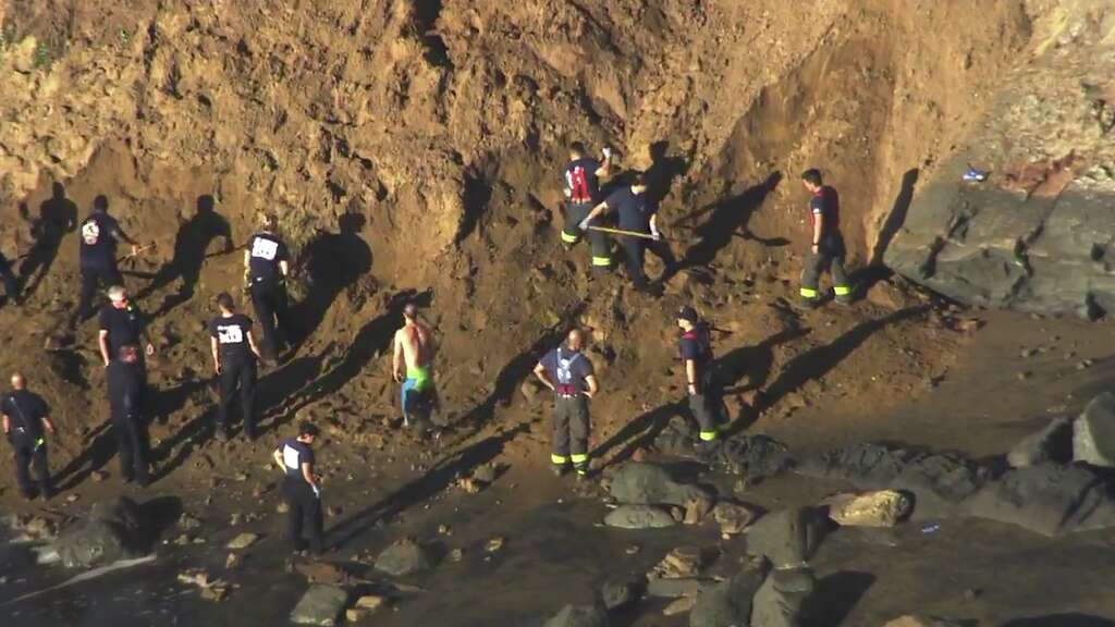 Search suspended for woman buried after cliff collapses at Fort Funston