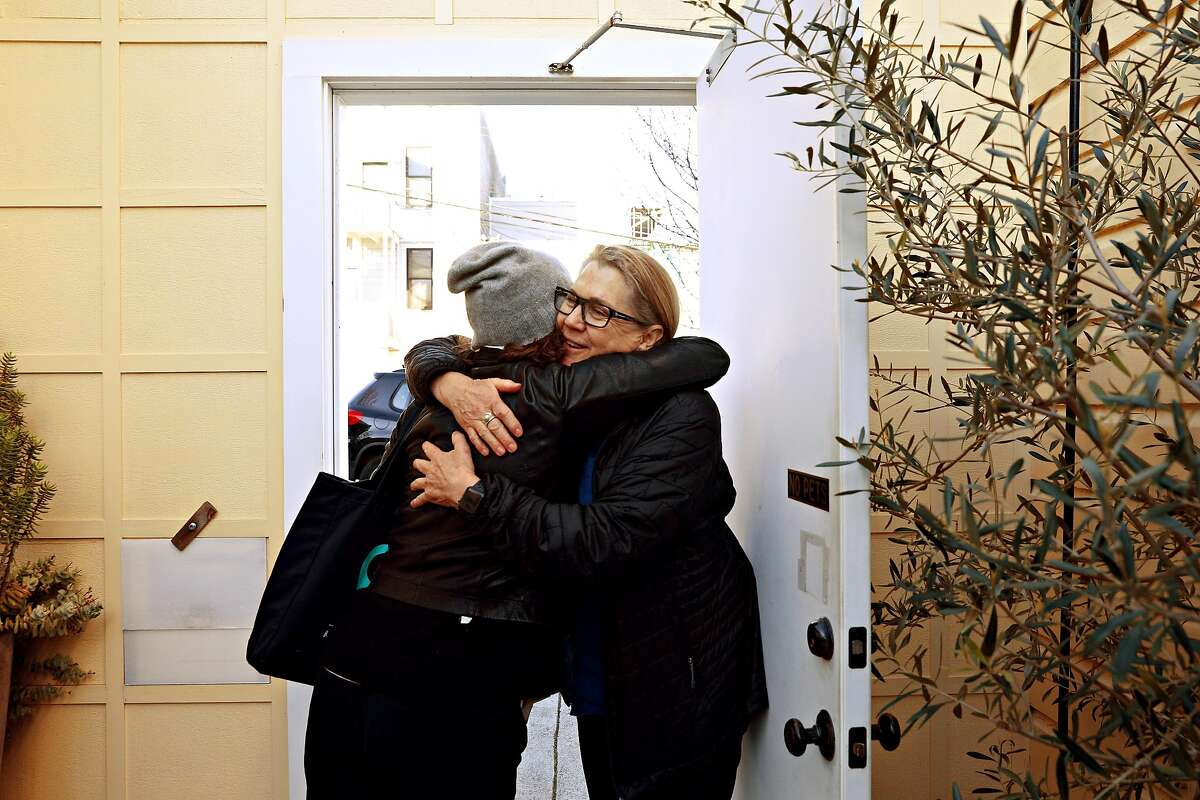 Cheryl Guerdoubian (left) of New York gives Airbnb host Kepa Askenasy (right) a hug as she leaves after breakfast at Askenasy's property on Wednesday, February 6, 2019 in San Francisco, Calif. Askenasy decided to invite guests to stay for free as her personal guests after she had to cancel all her upcoming bookings for more than 4 days out after San Francisco regulators recently revoked Askenasy's permit for short-term rentals as part of a crackdown.