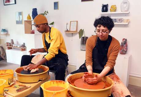 Jamari Hicks (left) with Janet Vega (right) both from Los Angeles take a pottery class through Airbnb Experiences on Thursday, Feb. 14, 2019, in San Francisco, Calif.