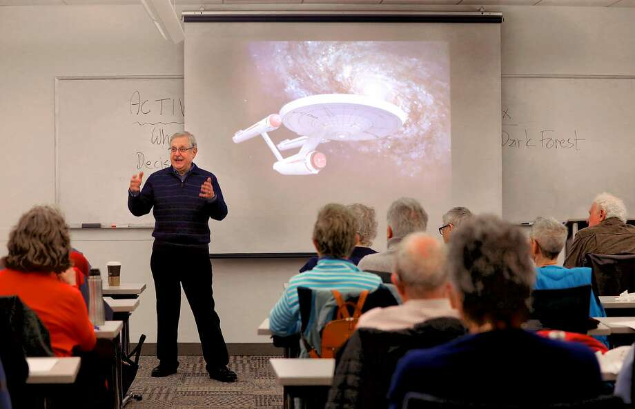 Andrew Fraknoi, an astronomer and board member of Search for Extraterrestrial Intelligence, known as SETI, teaches a class at San Francisco State University's downtown campus. Photo: Liz Hafalia / The Chronicle