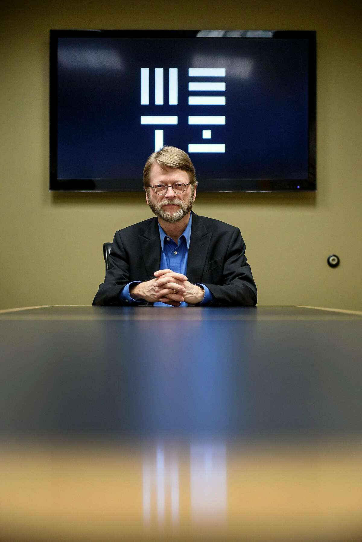 METI(Messaging Extra-Terrestrial Intelligence) President Douglas Vakoch, Ph.D., sits for a portrait in front of the METI logo at their offices in San Francisco, Calif., on Thursday, February 7, 2019.