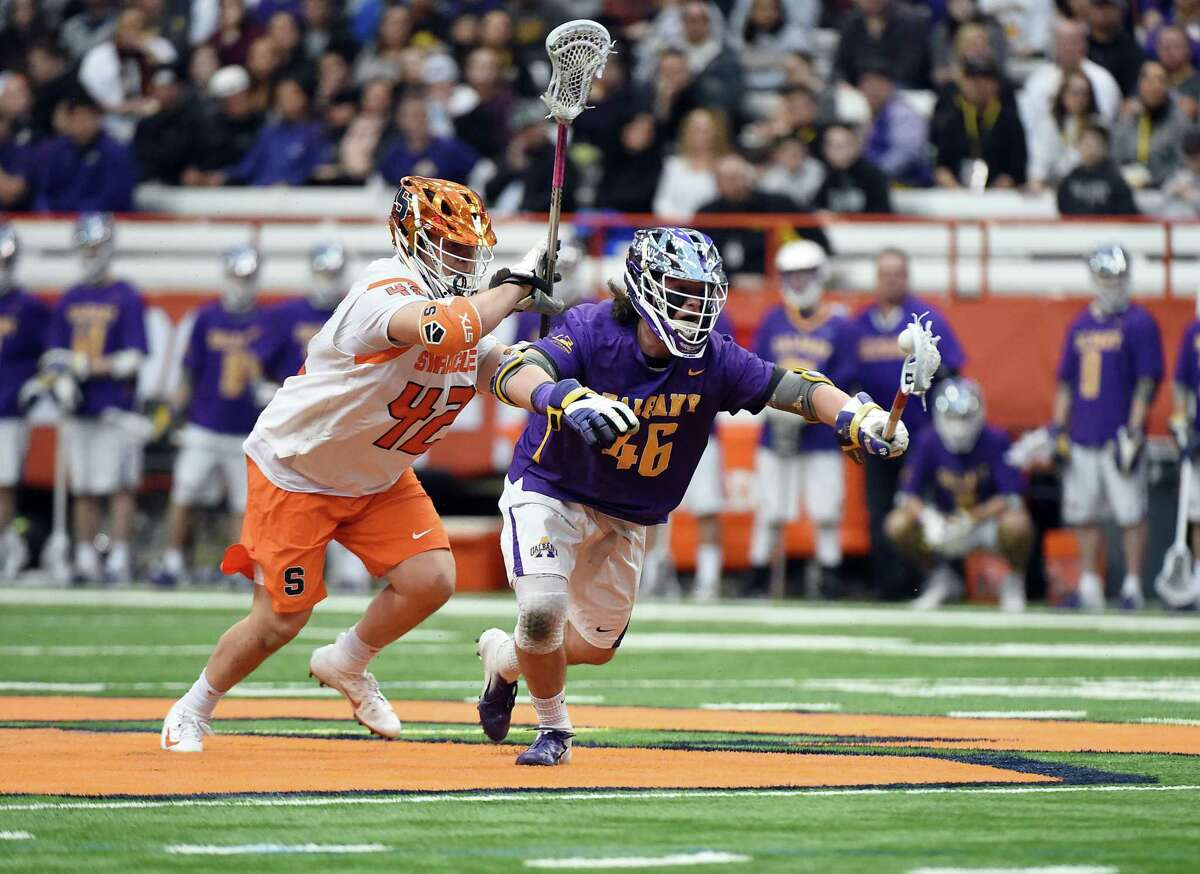 UAlbany's Austin Jones comes away with a faceoff against Syracuse in the season opener. Jones was 10-for-16 in his first game replacing TD Ierlan, who transferred to Yale. (Courtesy of UAlbany)