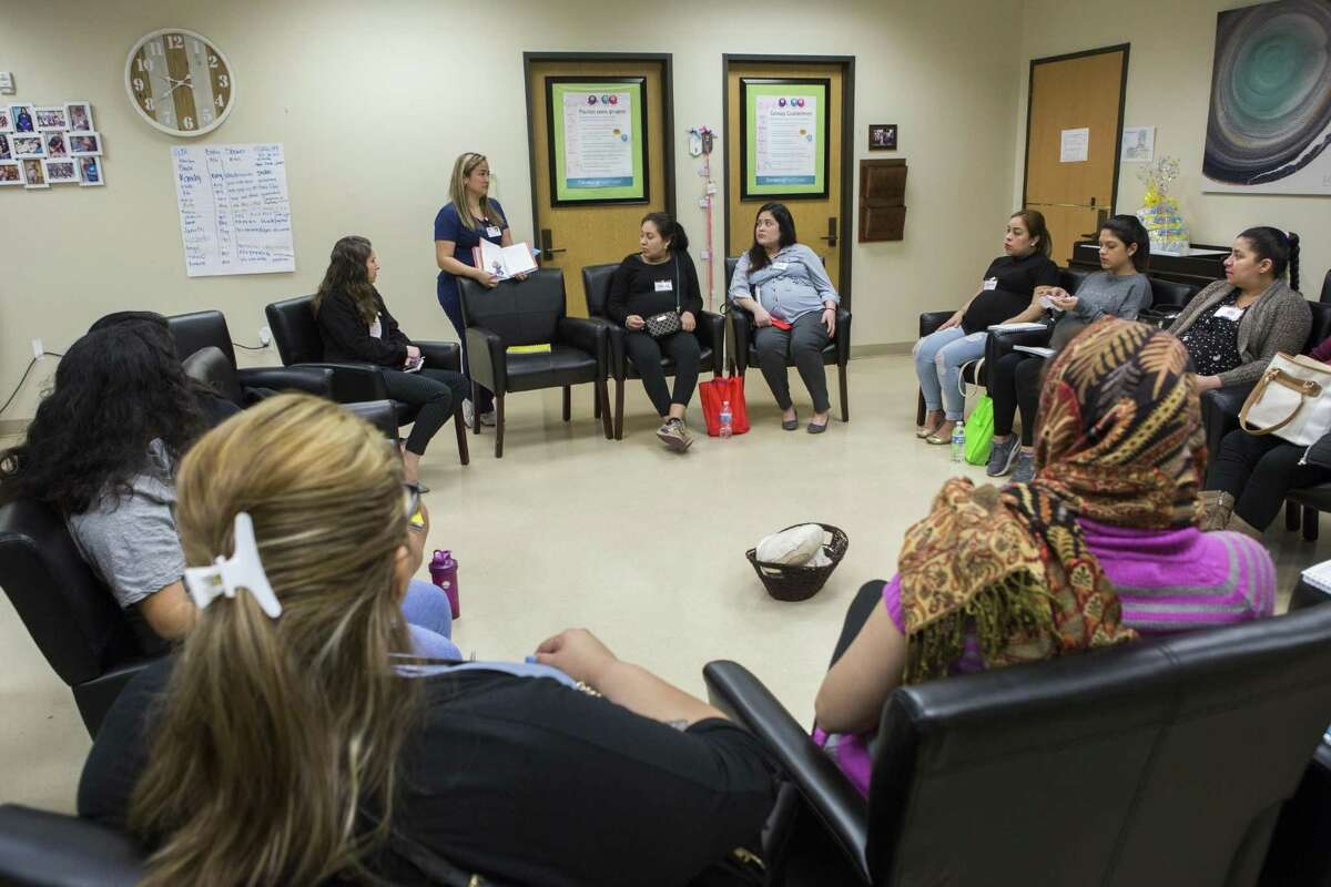 Women gather for a Centering Pregnancy session at El Centro de Corazón in Houston. Marci Mir, CEO of the clinic, says many more women could have been served with family planning cash earmarked for the Heidi Group.
