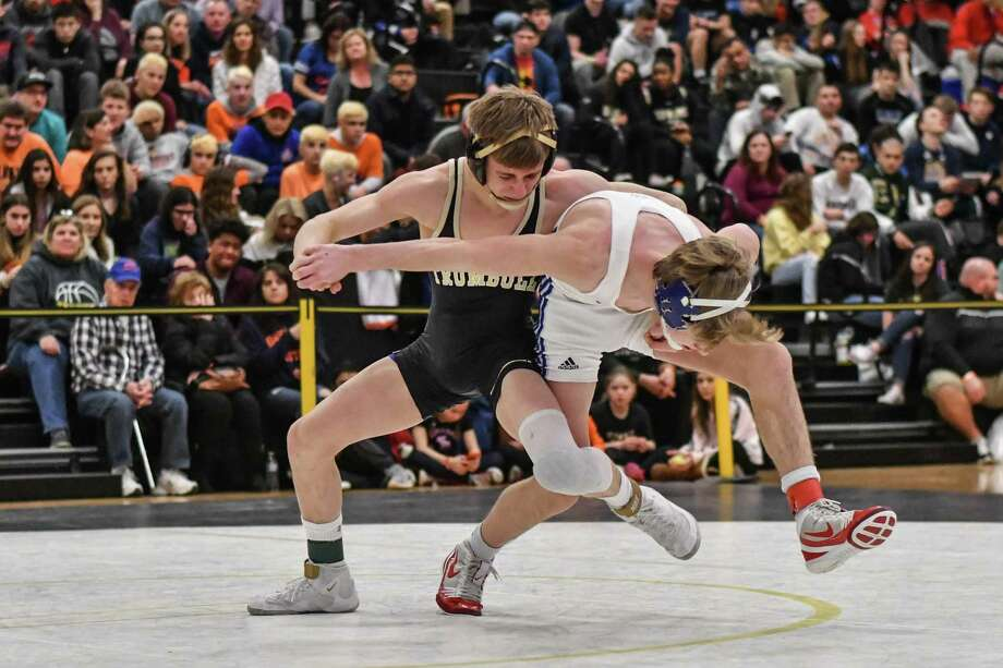 Travis Longo of the Trumbull Eagles and Drew Currier of Hall wrestle in the 113lb weight class during the CIAC Class LL finals on Saturday February 16, 2019 at Trumbull High School in Trumbull, Connecticut. Photo: Gregory Vasil / For Hearst Connecticut Media / Connecticut Post Freelance