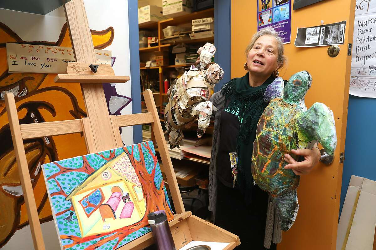 Art teacher Deborah Green holds turtles from her supply room at Oakland Technical High School on Wednesday, Feb. 13, 2019, in Oakland, Calif. Recycled items of newspaper and plastics were used in making the turtles. She also works on grants and finds usable items to be used for her student's school art projects.