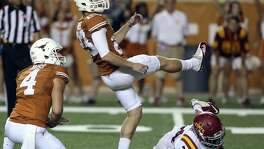 Nick Rose watches his game winning field goal pass through the uprights as Texas beats Iowa State 48-45 at Royal Memorial Stadium on October 18, 2014.