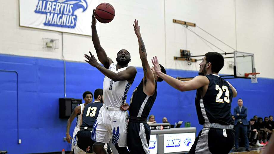 Senior point guard Ryan Pittman (1) and the Albertus Magnus men's basketball team will face Christopher Newport on Friday in the first round of the NCAA tournament. Photo: Ron Waite / Photosportacular / RON WAITE