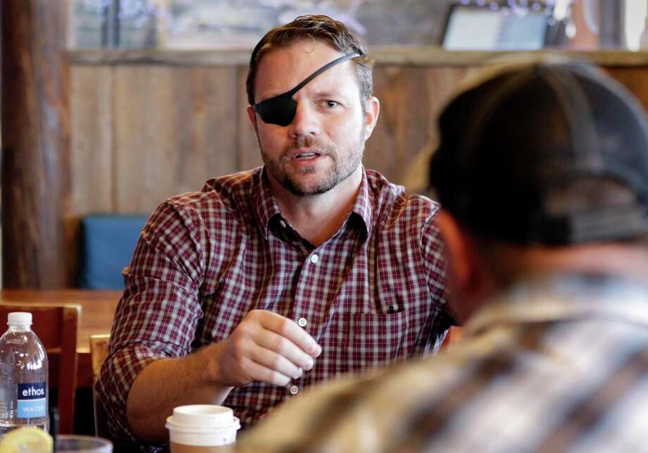 Dan Crenshaw, candidate for the 2nd congressional district, chats with other volunteers waiting for donated supplies to arrive for hurricane Florence victims at a collection station at the Bluewater Seafood Restaurant Saturday, Sep. 22, 2018 in Spring, TX. Photo: Michael Wyke, Houston Chronicle / Contributor / © 2018 Houston Chronicle