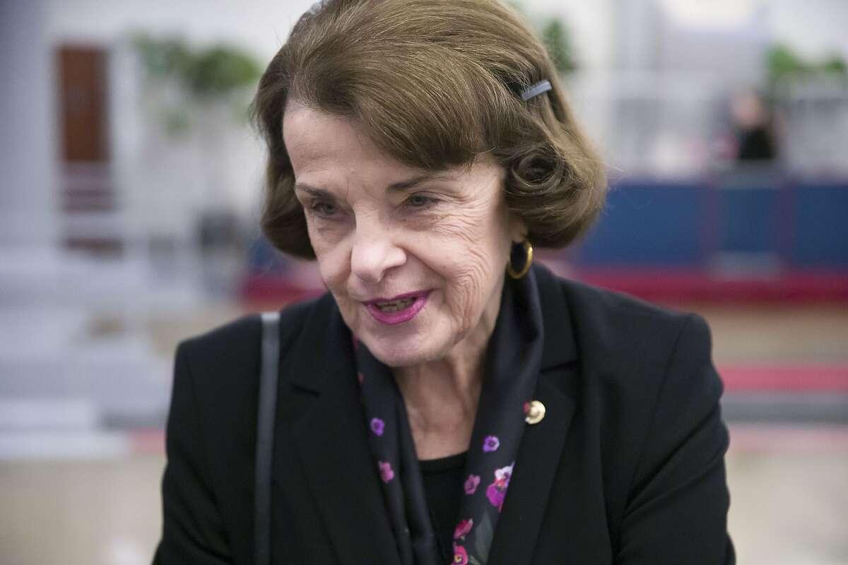 Sen. Dianne Feinstein, D-Calif., speaks with a reporter on Capitol Hill, Tuesday, Feb. 5, 2019 in Washington. (AP Photo/Alex Brandon)