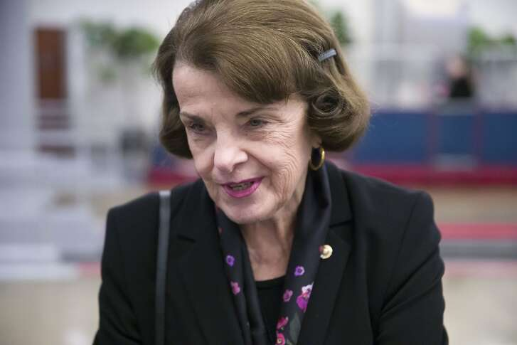 Sen. Dianne Feinstein, D-Calif., speaks with a reporter on Capitol Hill, Tuesday, Feb. 5, 2019 in Washington. (AP Photo/Alex Brandon)
