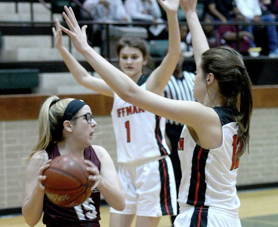 Silsbee's Sydni Whitted is pressed by Huffman's Kylie Willis during a bi-district playoff game at East Chambers on Feb.11, 2019. Photo: Kim Brent / The Enterprise / BEN