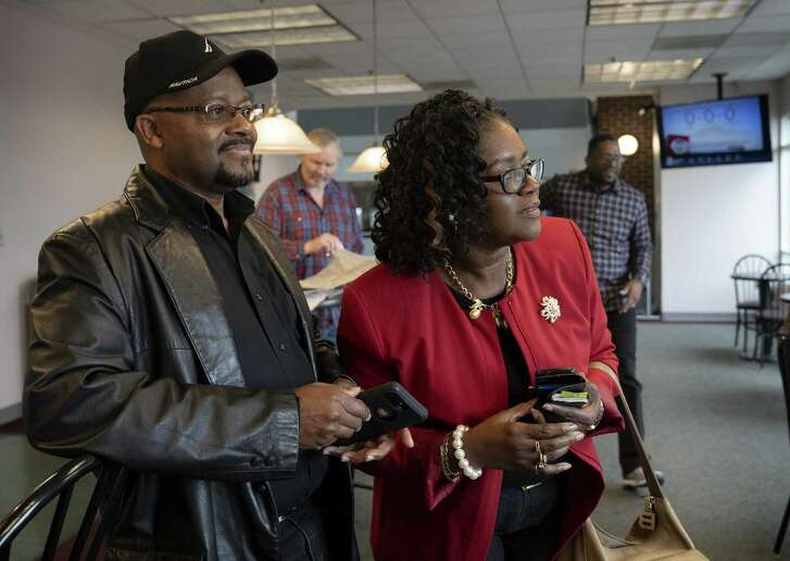 """Gerald Streat (left) and Gwen Akers-Booker watch for the airplane flying their brother, Morris James, to Lynchburg Regional Airport to meet for the first time on Thursday. Feb. 14, 2019 in Lynchburg, Va. Recently James found out he had six younger siblings through a match with a cousin on Ancestry.com. """"It's like going on a blind date,"""" said Streat. Photo by Jill Nance"""