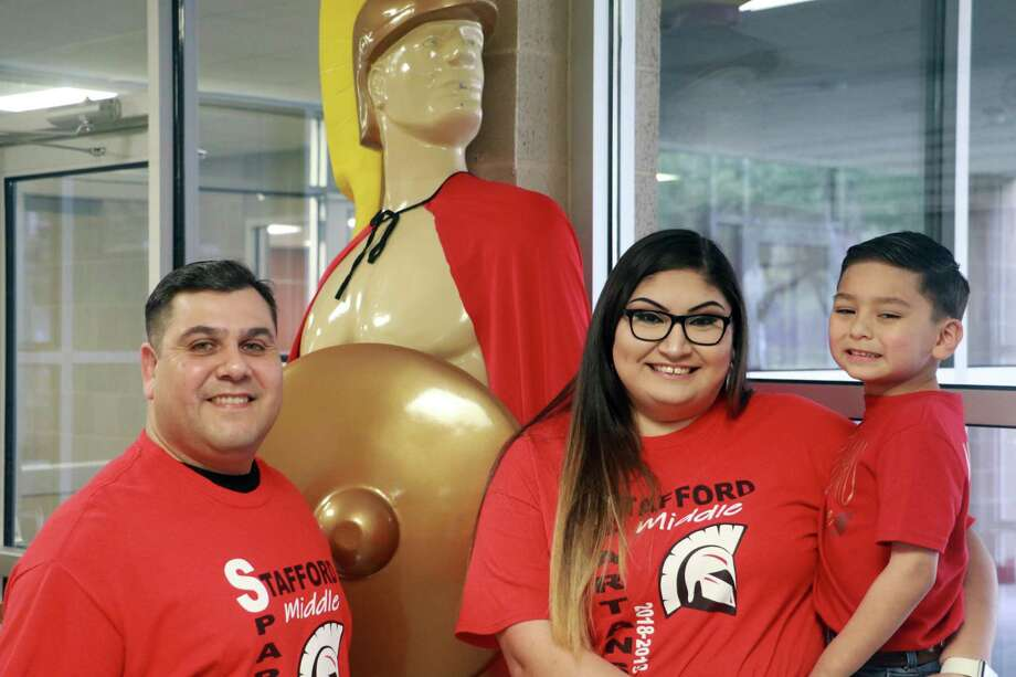 From left, Danny Zamora Sr., his daughterAlyonna Gonzalez and her sonVictor form Stafford MSD's first three-generation family. Photo: Stafford MSD