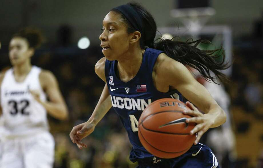 UConn guard Mikayla Coombs looks for room against Central Florida on Feb. 17 in Orlando, Fla. Photo: Reinhold Matay / Associated Press / Reinhold Matay