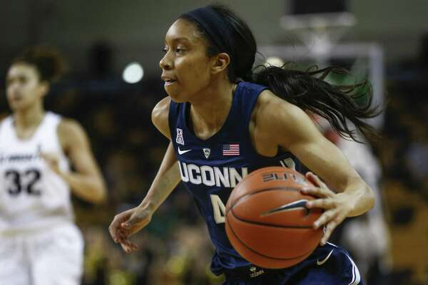 UConn guard Mikayla Coombs looks for room against Central Florida on Feb. 17 in Orlando, Fla.