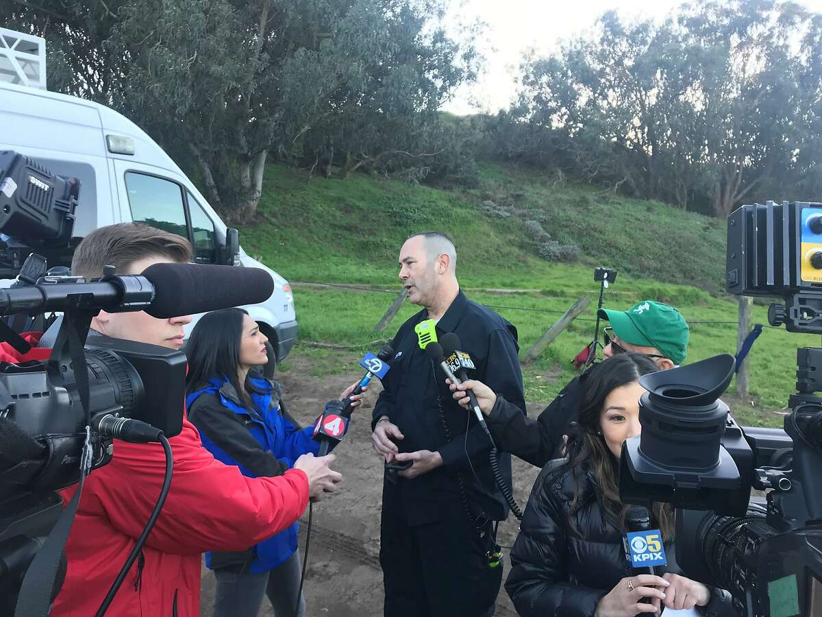 Lt. John Baxter, the Francisco Fire Department, updates the media on the Fort Funston rescue effort