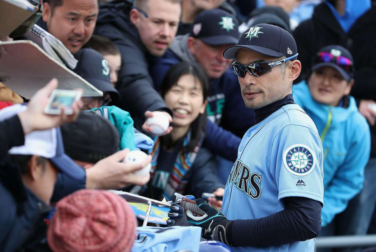 PEORIA, ARIZONA - FEBRUARY 22: Ichiro Suzuki #51 of the Seattle Mariners signs autographs for fans before the MLB spring training game against the Oakland Athletics at Peoria Stadium on February 22, 2019 in Peoria, Arizona. (Photo by Christian Petersen/Getty Images)