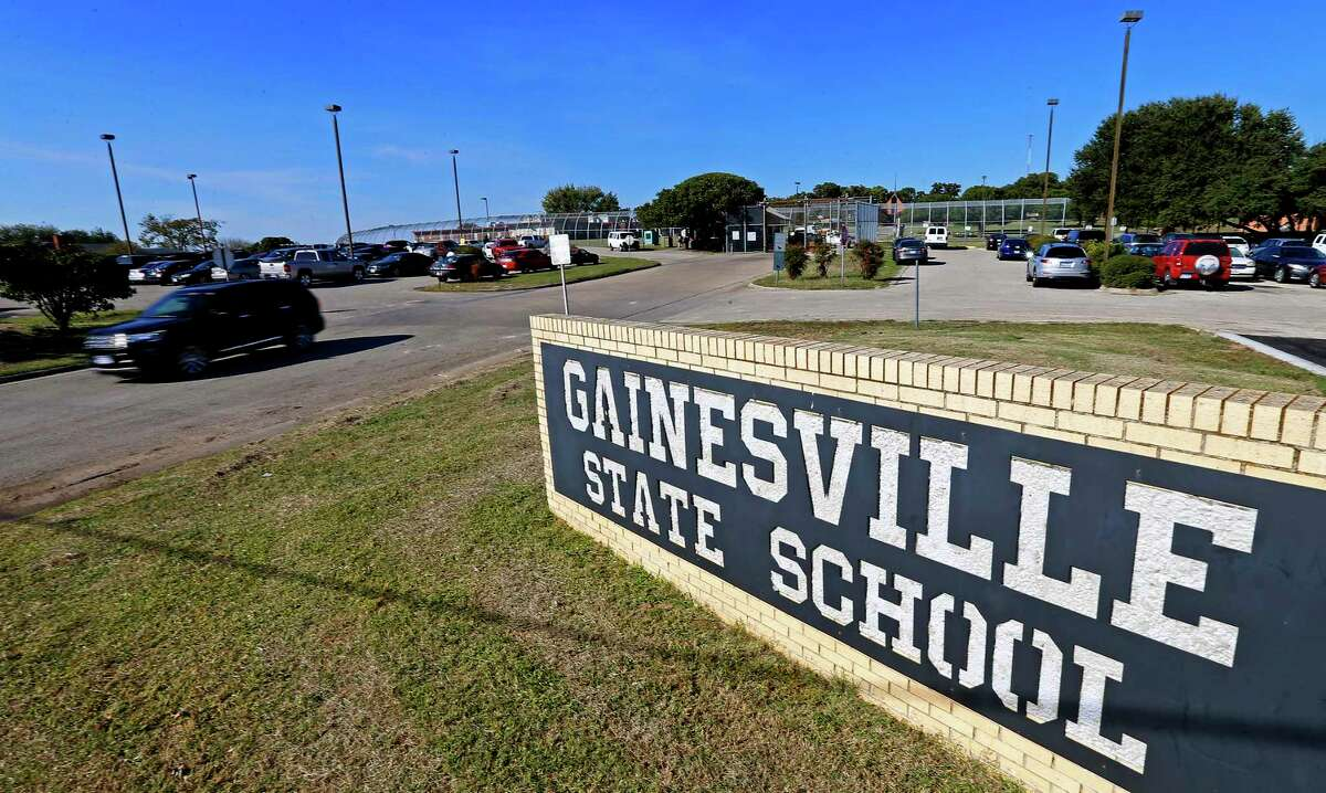 In this Friday, Oct. 28, 2016 photo, an SUV leaves the Gainesville State School in Gainesville, Texas.