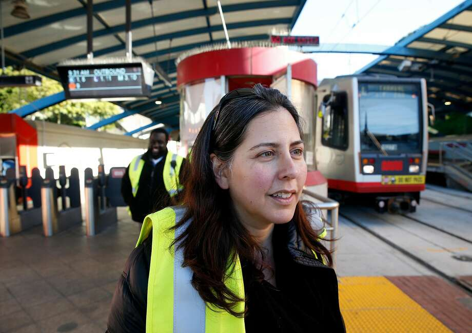 FILE - Julie Kirschbaum, the acting director of Muni, visits the West Portal transit station in San Francisco, Calif. on Friday, Feb. 22, 2019. Traffic officers have been assigned to the intersection of West Portal Avenue and Ulloa Street for the past few weeks to control the often congested flow of cars, trucks, buses and streetcars. Photo: Paul Chinn / The Chronicle