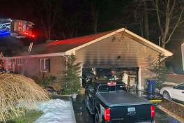 Firefighters in Trumbull, Conn., extinguished a garage fire on Feb. 21, 2019.
