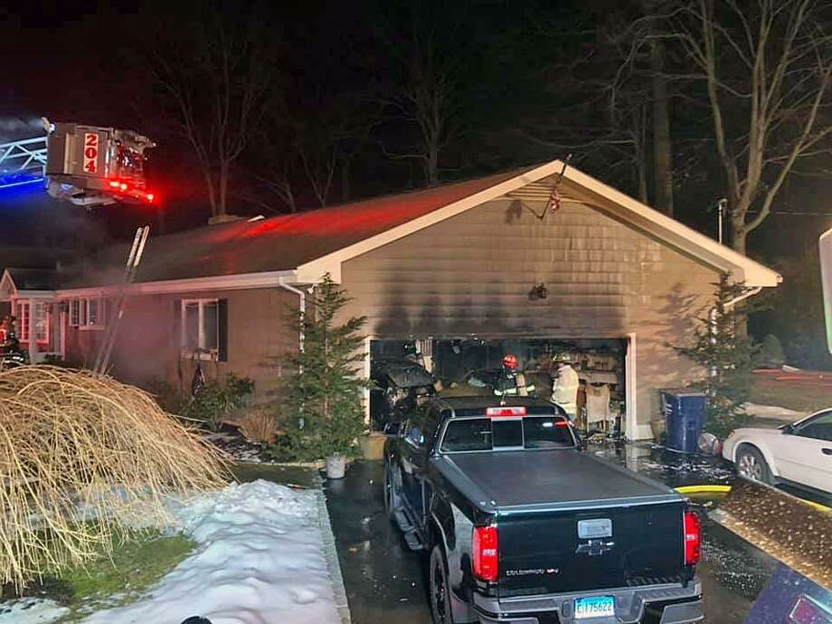 Firefighters in Trumbull, Conn., extinguished a garage fire on Feb. 21, 2019. Photo: Contributed Photo / Long Hill Volunteer Fire Department