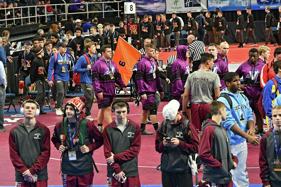 Wrestlers participate in the parade of champions to start off the New York State High School Wrestling Championships at the Times Union Center on Friday, Feb. 22, 2019 in Albany, N.Y. (Lori Van Buren/Times Union)