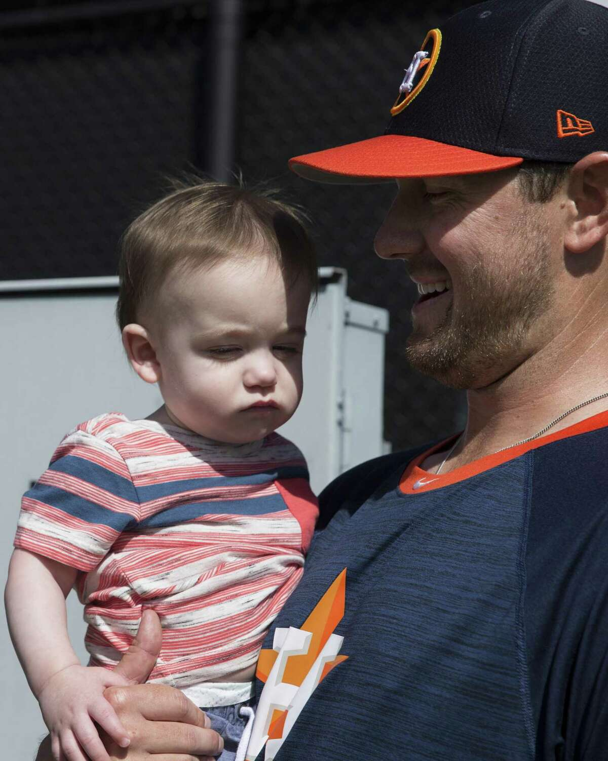 Houston Astros right handed pitcher Brady Rogers' 10-month-old son, Bennett, visits him at Fitteam Ballpark of The Palm Beaches on Day 8 of spring training on Thursday, Feb. 21, 2019, in West Palm Beach.