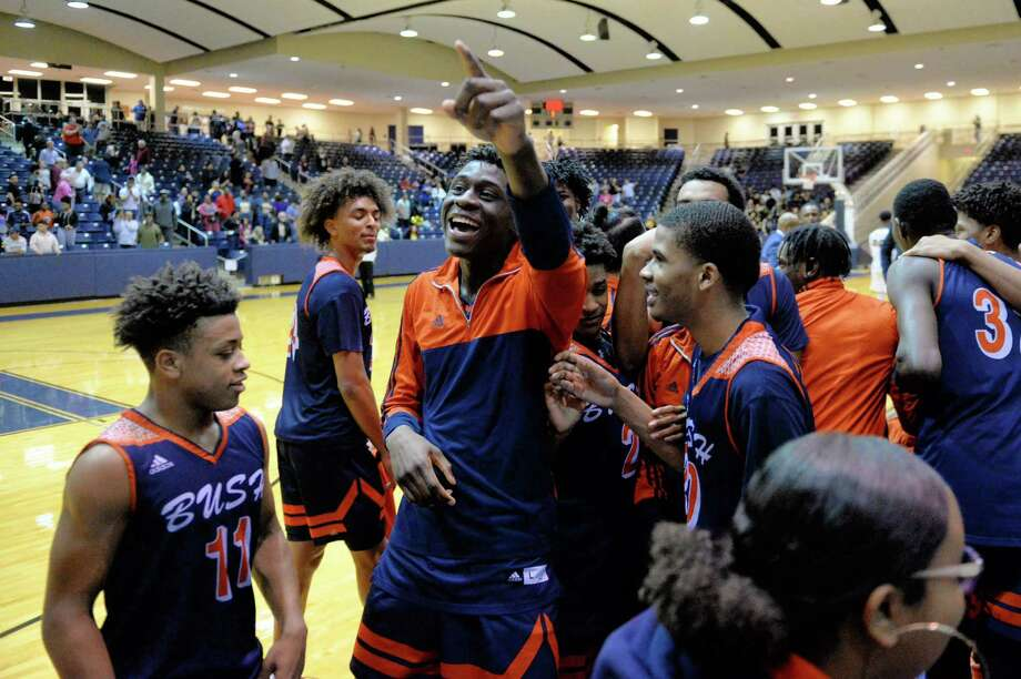 The Fort Bend Broncos celebrate their 52-46 victory over the Spring Woods Tigers in a Class 6A, Region III area-round basketball playoff game on Friday, February 22, 2019 at Coleman Coliseum, Houston, TX. Photo: Craig Moseley, Staff Photographer / ©2019 Houston Chronicle
