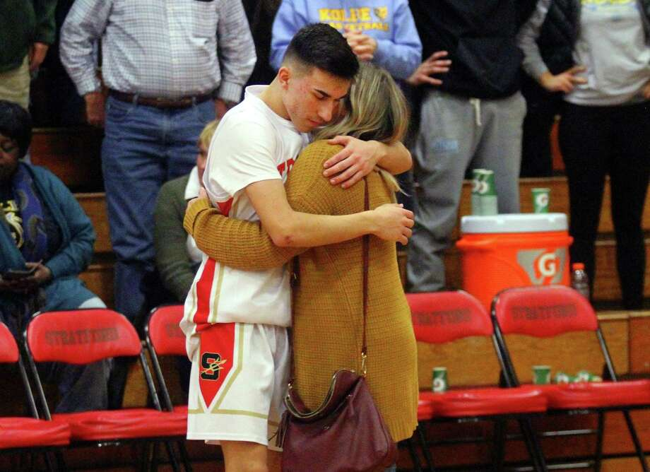 Stratford's Zach Fedak receives a hug from his sister Nicole after Kolbe Cathedral handed Stratford a defeat in boys basketball quarterfinal action in Stratford, Conn., on Friday Feb. 22, 2019. Kolbe beat Stratford 61 to 54. Photo: Christian Abraham / Hearst Connecticut Media / Connecticut Post