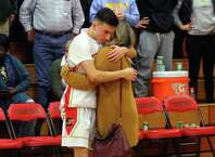 Stratford's Zach Fedak receives a hug from his sister Nicole after Kolbe Cathedral handed Stratford a defeat in boys basketball quarterfinal action in Stratford, Conn., on Friday Feb. 22, 2019. Kolbe beat Stratford 61 to 54.
