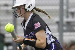 Hannah Earls #6 of Willis bunts the ball for a single during the first inning of Game 2 in Region III-5A area series, Friday, May 4, 2018, in Lufkin.