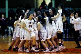Lowell Cardinals senior guard Lauren Chan (25) and her team celebrate following the CIF San Francisco Section Girls Championship against the Lincoln Mustangs at Kezar Pavilion on Friday, Feb. 22, 2019, in San Francisco, Calif. The Cardinals won 49-43.