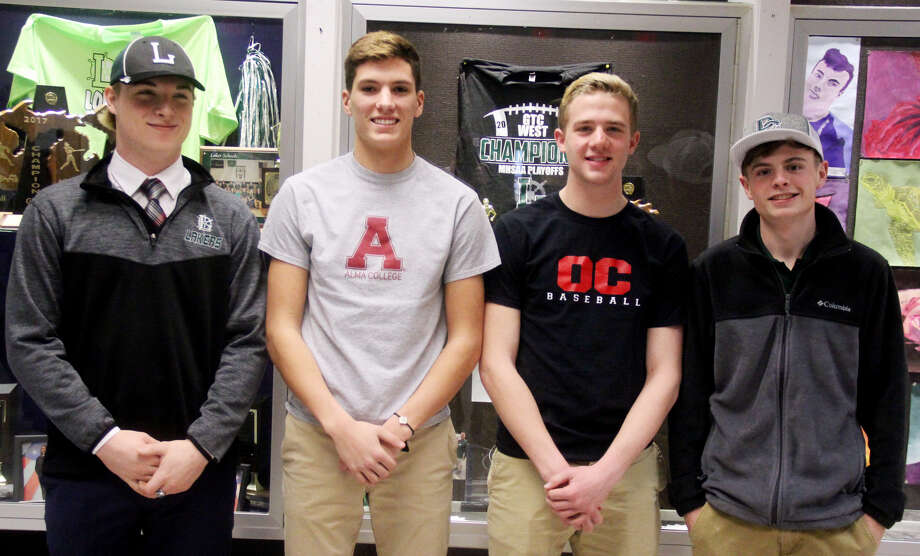 A quartet of EPBP athletes will continue their careers at the next level. From left, Preston Warren (Alma Football), Adam LeGault (Alma Football) Andrew Siegfried (Olivet Baseball) and Brady Rosenthal (Delta Golf). (Mike Gallagher/Huron Daily Tribune)