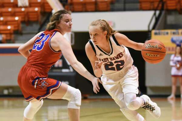 Hardin-Jefferson's Makenna Henry gets around defending Midlothian-Heritage's Saige Klor during the second half of the regional semi-finals playoff game at Sam Houston State University on Friday. Photo taken on Friday, 02/22/19. Ryan Welch/The Enterprise