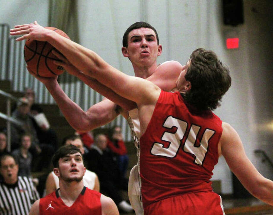 Calhoun's Drew Baalman scored 21 points the Class 1A regional championship game Friday night n Hardin against Madison, but his team saw its season come to an end with a 66-54 loss to the Trojans. Baalman is shown in action earlier this season against Staunton. Photo: Telegraph File Photo